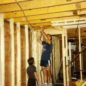 Dad and Greg (10.5 yrs) working on basement wiring 8-88