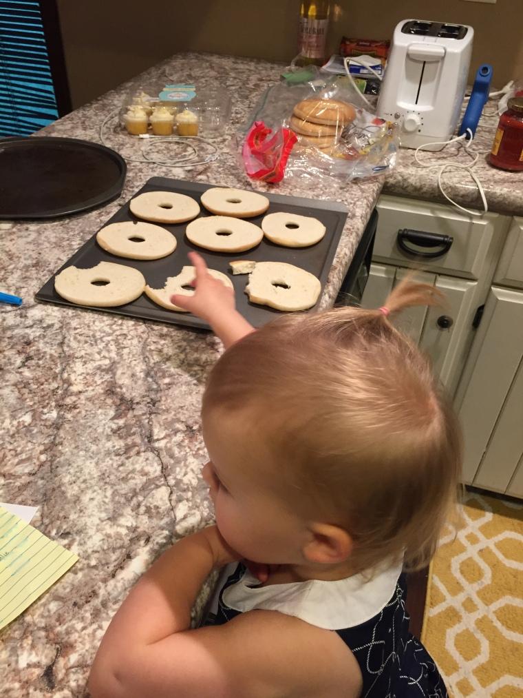 Josie helping make pizza bagels 9-5-15